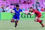 Tom Glyn Willians of Wales (R) tries to tackle Laaloi Leilua of Samoa (L) during the HSBC Hong Kong Sevens 2018 Shield Final match between Samoa and Wales on April 8, 2018 in Hong Kong, Hong Kong. Photo by Marcio Rodrigo Machado / Power Sport Images