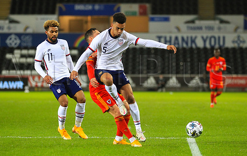 12th November 2020; Liberty Stadium, Swansea, Glamorgan, Wales; International Football Friendly; Wales versus United States of America; Antonee Robinson of USA and Connor Roberts of Wales challenge for the ball