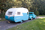 SS Ford F-100 223 Inline 6 pulling a 13-foot 1964 Serro Scotty travel trailer.  The sea foam green is the Ford's original color.
