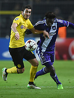 Dortmund's Nuri Sahin (L) and Anderlecht's Fabrice N'Sakala vie for the ball during the Champions League Group D football match between Borussia Dortmund and RSC Anderlecht in the Signal Iduna Park in Dortmund, Germany, 09 December 2014. Photo: MARIUS BECKER/dpa