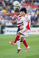 Amy LePeilbet (6) of the United States (USA) and Ren Guixin (6) of China (CHN) go for a header. The United States (USA) women defeated China PR (CHN) 4-1 during an international friendly at PPL Park in Chester, PA, on May 27, 2012.