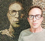 Pictured: Justin with a self portrait of himself made from pebbles.  Created in his cabin in Thailand due to the rainy season.<br /> <br /> A British artist stuck in Thailand has spent his time constructing masterpieces from pebbles for locals to enjoy.  Justin Bateman had only planned on staying in Chiang Mai for a week - but has remained there now for nearly ten months after the pandemic struck. <br /> <br /> His pebble portraits include The Queen, Spanish painter Pablo Picasso, Michelangelo's David and a local farmer - who was bemused by his portrait.   Mr Bateman, from Portsmouth, Hants, was staying in Bali when he travelled to Chiang Mai, in Thailand, to visit some friends.   SEE OUR COPY FOR DETAILS.<br /> <br /> Please byline: Justin Bateman/Solent News<br /> <br /> © Justin Bateman/Solent News & Photo Agency<br /> UK +44 (0) 2380 458800