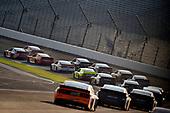 #18: Kyle Busch, Joe Gibbs Racing, Toyota Camry Skittles Red White & Blue and #42: Matt Kenseth, Chip Ganassi Racing, Chevrolet Camaro McDelivery