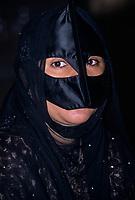 Muscat, Oman.  Omani Woman Wearing a Face Mask (Burqa).