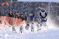 Sunday February 27, 2010   Ilsa Schwarzburg leaves the start line of the Junior Iditarod at Willow Lake , Alaska
