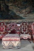 The ante-room is lined with early-eighteenth century chairs and a daybed in original velvet coverings
