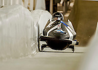 8 January 2016: Nicole Vogt, piloting her 2-man bobsled for the United States of America, kisses the sidewall as she enters the Chicane straightaway on her first run, ending the day with a combined 2-run time of 1:55.84 and earning an 8th place finish at the BMW IBSF World Cup Championships at the Olympic Sports Track in Lake Placid, New York, USA. Mandatory Credit: Ed Wolfstein Photo *** RAW (NEF) Image File Available ***