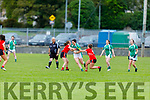 Na Gaeil's Meabh Barry been well marshalled by Sarah Murphy and Caroline Reen of Rathmore in the Randles Bros Kerry LGFA Senior Football Championship.