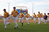 LSU Tiger baseball team warms up at Alex Box Stadium before the NCAA Super Regional baseball game on June 10, 2012 in Baton Rouge, Louisiana.(Andrew Woolley/Four Seam Images)