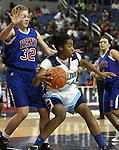 Reno's Morgan McGwire defends Centennial's Breanna Workman during a semi-final game at the NIAA 4A State Basketball Championships between Centennial and Reno high schools at Lawlor Events Center in Reno, Nev, on Thursday, Feb. 23, 2012. .Photo by Cathleen Allison