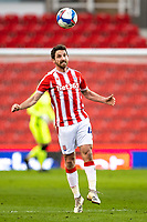 6th February 2021; Bet365 Stadium, Stoke, Staffordshire, England; English Football League Championship Football, Stoke City versus Reading; Joe Allen of Stoke City heads the ball clear