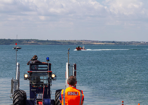 Skerries RNLI returning to shore with the kayakers on board