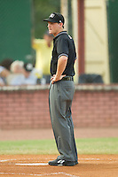 Umpire Ryan Clark prior to the start of an Appalachian League game between the Kingsport Mets and the Elizabethton Twins at Joe O'Brien Field August 14, 2010, in Elizabethton, Tennessee.  Photo by Brian Westerholt / Four Seam Images