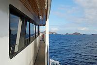 Scuba divers live on board cruise boat arriving at Bartolome Island, Ecuador, Galapagos Archipelago