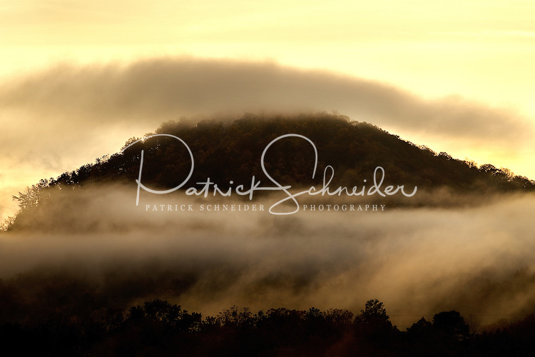 A cloud of fog flanks the Blue Ridge Mountains near Asheville, NC.