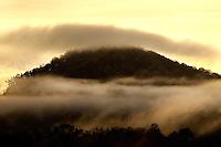 A cloud of fog flanks the Blue Ridge Mountains near Asheville, NC.