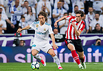 Luka Modric of Real Madrid competes for the ball with Inigo Cordoba Kerejeta of Athletic Club de Bilbao during the La Liga 2017-18 match between Real Madrid and Athletic Club Bilbao at Estadio Santiago Bernabeu on April 18 2018 in Madrid, Spain. Photo by Diego Souto / Power Sport Images