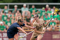 NEWTON, MA - MAY 22: Jenn Medjid #35 of Boston College on the attack as Erin McBride #11 of Notre Dame defends during NCAA Division I Women's Lacrosse Tournament quarterfinal round game between Notre Dame and Boston College at Newton Campus Lacrosse Field on May 22, 2021 in Newton, Massachusetts.