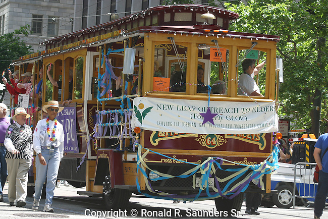 STREET TROLLEY in GAY PRIDE PARADE REPRESENTING ELDERLY GAYS WHO SUPPORT ALTERNATIVE LIFESTYLES