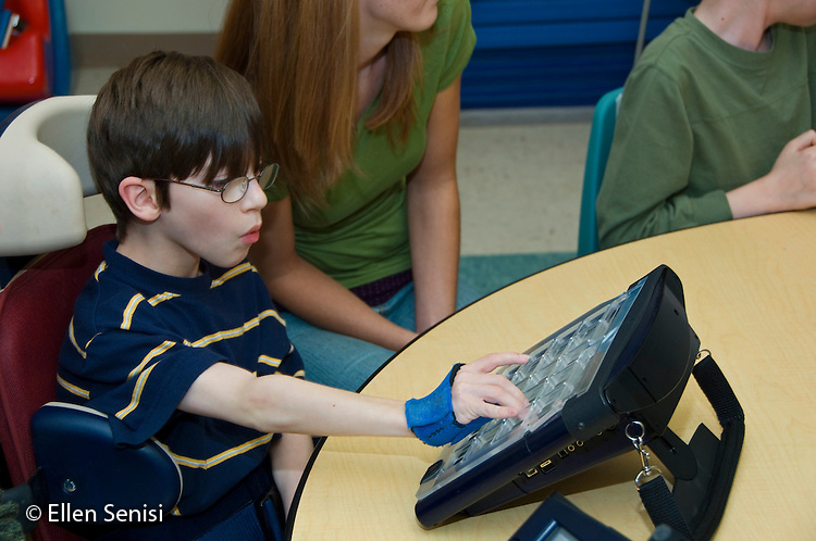 MR / Albany, NY.Langan School at Center for Disability Services .Ungraded private school which serves individuals with multiple disabilities.Boy (boy, 9, cerebral palsy, limited verbal output with expressive and receptive language delays) uses alternative and augmentative communication device during speech and language development lesson. He is wearing hand splints to help him isolate his thumbs which helps him use the device more easily..MR: Rub1.© Ellen B. Senisi
