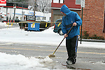 HARWINTON, CT - 7 January, 2009 -  010709MO05 - Torrington resident Travis Madden uses a broom to clear slush and ice from the end of a Church Street driveway Wednesday afternoon. Jim Moore Republican-American.