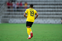 ORLANDO, FL - JULY 20: Adrian Mariappa #19 of Jamaica running during a game between Costa Rica and Jamaica at Exploria Stadium on July 20, 2021 in Orlando, Florida.