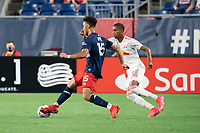 FOXBOROUGH, MA - MAY 22: Wilfrid Katoum #5 of New England Revolution advances towards the New York Red Bulls goal as Kyle Duncan #6 of New York Red Bulls pressures during a game between New York Red Bulls and New England Revolution at Gillette Stadium on May 22, 2021 in Foxborough, Massachusetts.