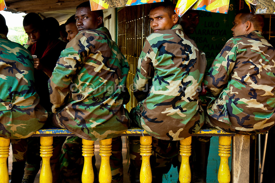 Soldiers of the Colombian paramilitary forces (AUC) waiting for demobilization in a jungle settlement Casibare, in the Meta Department, Colombia, 9 April 2006.