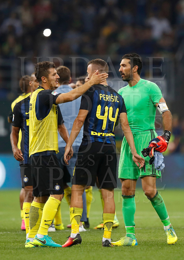 Calcio, Serie A: Inter vs Juventus. Milano, stadio San Siro, 18 settembre 2016.<br /> Juventus' goalkeeper Gianluigi Buffon, right, greets Inter's Ivan Perisic, center, and Stevan Jovetic, at the end of the Italian Serie A football match between FC Inter and Juventus at Milan's San Siro stadium, 18 September 2016. Inter won 2-1.<br /> UPDATE IMAGES PRESS/Isabella Bonotto