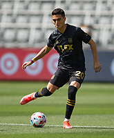 LOS ANGELES, CA - APRIL 17: Eduard Atuesta #20 of LAFC passes off the ball during a game between Austin FC and Los Angeles FC at Banc of California Stadium on April 17, 2021 in Los Angeles, California.