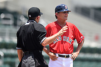 GCL Red Sox manager Tom Kotchman (11) listens to umpire Josh Havens explaining his call on a disputed foul ball during a game against the GCL Rays on June 25, 2014 at JetBlue Park at Fenway South in Fort Myers, Florida.  GCL Red Sox defeated the GCL Rays 7-0.  (Mike Janes/Four Seam Images)