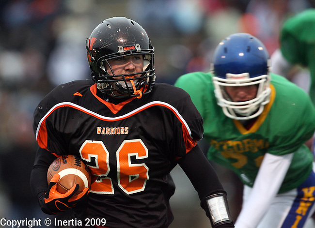 SIOUX FALLS, SD - OCTOBER 22:  Chris McMartin #26 of Washington looks to turn the corner past Mike Hardie #85 of O'Gorman in the first quarter of their game Thursday night at Howard Wood Field. (Photo by Dave Eggen/Inertia).