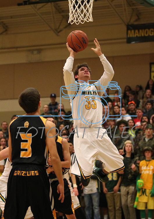 Manogue's Jack Mayer shoots over Galena's Scott Geerling at Manogue High School in Reno, Nev., on Tuesday, Feb. 11, 2014. Manogue won 51-29.<br /> Photo by Cathleen Allison