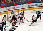 December 14, 2019:  Alex Carpenter [#25] scores Team USA's final goal in a 4-1 victory over Canada. The feisty opening game of a five-match series took place at the XL Center in Hartford, Connecticut. Heary/Eclipse Sportswire/CSM
