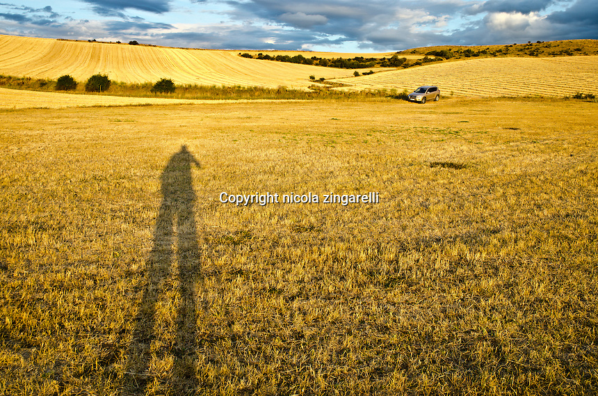 Shot of a spanish landscape and the silhouette of the photographer on the field. Summertime