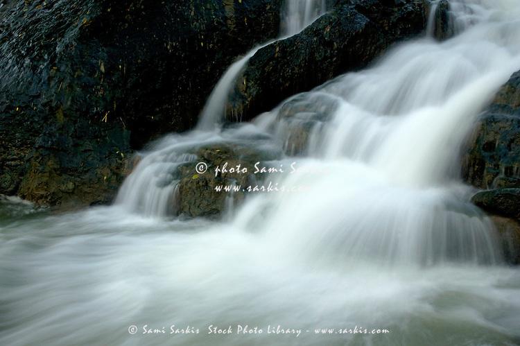 Waterfall cascading into Li Jiang River, Yangshuo, Guangxi, China.