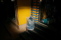 CHINA. Beijing. A bottle of water outside a shop. 2008