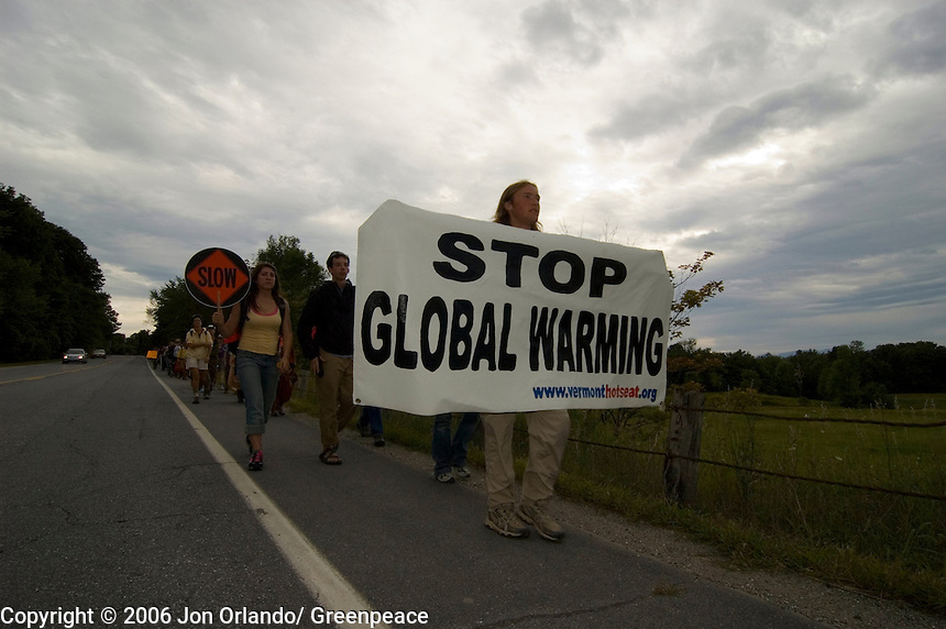 Robin Sleith of Green Mountain College leads marchers on the third day of a five day walk across Vermont to raise awareness on Global Warming.