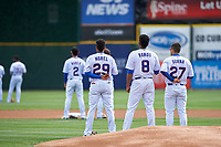 South Bend Cubs Christopher Morel (29), Eury Ramos (8), and Tyler Durna (27) during the National Anthem before a Midwest League game against the Cedar Rapids Kernels at Four Winds Field on May 8, 2019 in South Bend, Indiana. South Bend defeated Cedar Rapids 2-1. (Zachary Lucy/Four Seam Images)