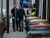 Pictured: A forensics police officer at West Street, Newport, south Wales, UK. Wednesday 20 September 2017<br /> Re: Two men have been arrested in south Wales over Friday's terror attack on a London Underground train, bringing the total number held to five.<br /> Two men, one 48 and the other 30 were detained under the Terrorism Act in the early hours, after a search at an address in Newport.<br /> Police are still searching there, and at a second address in Newport.<br /> Thirty people were injured when a homemade bomb partially exploded on a rush-hour Tube train at Parsons Green in south-west London.