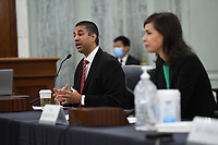Ajit Pai, Chairman, Federal Communications Commission (FCC), left, testifies during a United States Senate Committee on Commerce, Science, and Transportation oversight hearing to examine the Federal Communications Commission in Washington, DC on June 24, 2020. Jessica Rosenworcel, Commissioner, Federal Communications Commission (FCC) looks on at right.<br /> Credit: Jonathan Newton / Pool via CNP/AdMedia