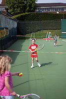 A Junior Tennis initiative training session at Wimbledon, The All England Lawn Tennis Club (AELTC), London..