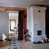 A series of patterned floor runners connect the various ground floor rooms of the house
