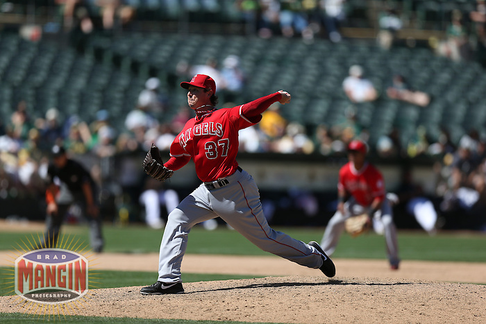 OAKLAND, CA - MAY 1:  Scott Downs #37 of the Los Angeles Angels pitches during the game against the Oakland Athletics at O.co Coliseum on May 1, 2013 in Oakland, California. Photo by Brad Mangin