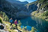 Hiking above Lago di Tome, along the Via Alta Via Maggia, a difficult week long trek from Locarno to Broglio, Switzerland.