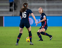ORLANDO, FL - FEBRUARY 24: Becky Sauerbrunn #4 of the USWNT passes the ball to Rose Lavelle #16 during a game between Argentina and USWNT at Exploria Stadium on February 24, 2021 in Orlando, Florida.