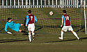 Whitehill's Aaron Somerville (10) scores their goal from the spot.