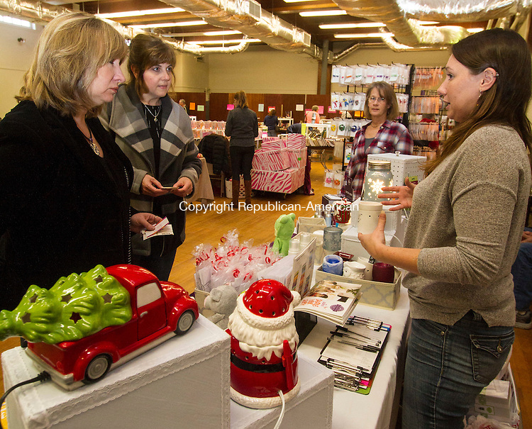 BEACON FALLS, CT - 05 NOVEMBER 2016 - 110516JW03.jpg -- Karen Rogers and Dina Zygmunt lean about Scentsy candles from sales representative Jessica Haven during the Friends of Beacon Falls Library Holiday Shopping Fair Saturday morning at St. Michaels Roman Catholic Church.    Jonathan Wilcox Republican-American