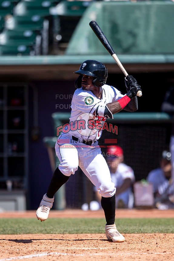 Lansing Lugnuts designated hitter Elvis Peralta (7) at bat on May 30, 2021 against the Great Lakes Loons at Jackson Field in Lansing, Michigan. (Andrew Woolley/Four Seam Images)