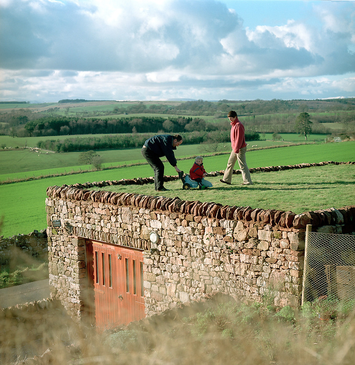© John Angerson<br /> Vet Helen Reddy and Huband Phil and son Tom, at their house in Heights, Cumbria. That is built underground on a hillside.  The extremly eco friendly home took only six months to build a fabulous example of sustainable dwelling.<br /> ends